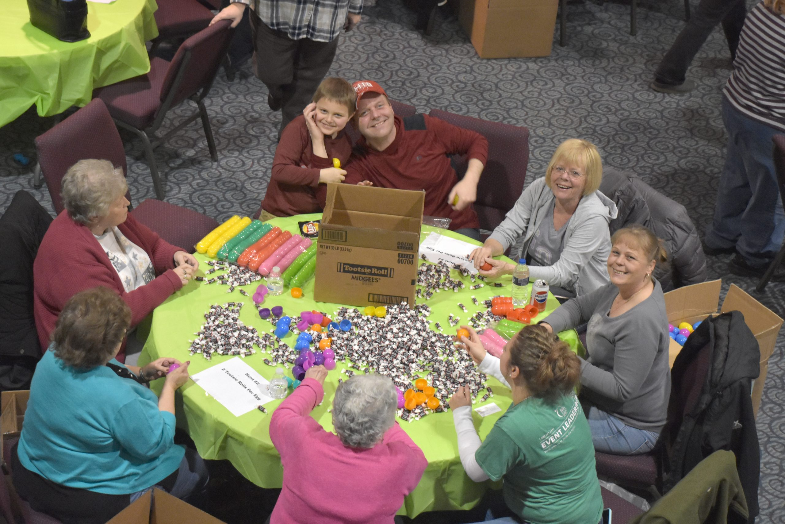 Volunteers stuffing Easter eggs