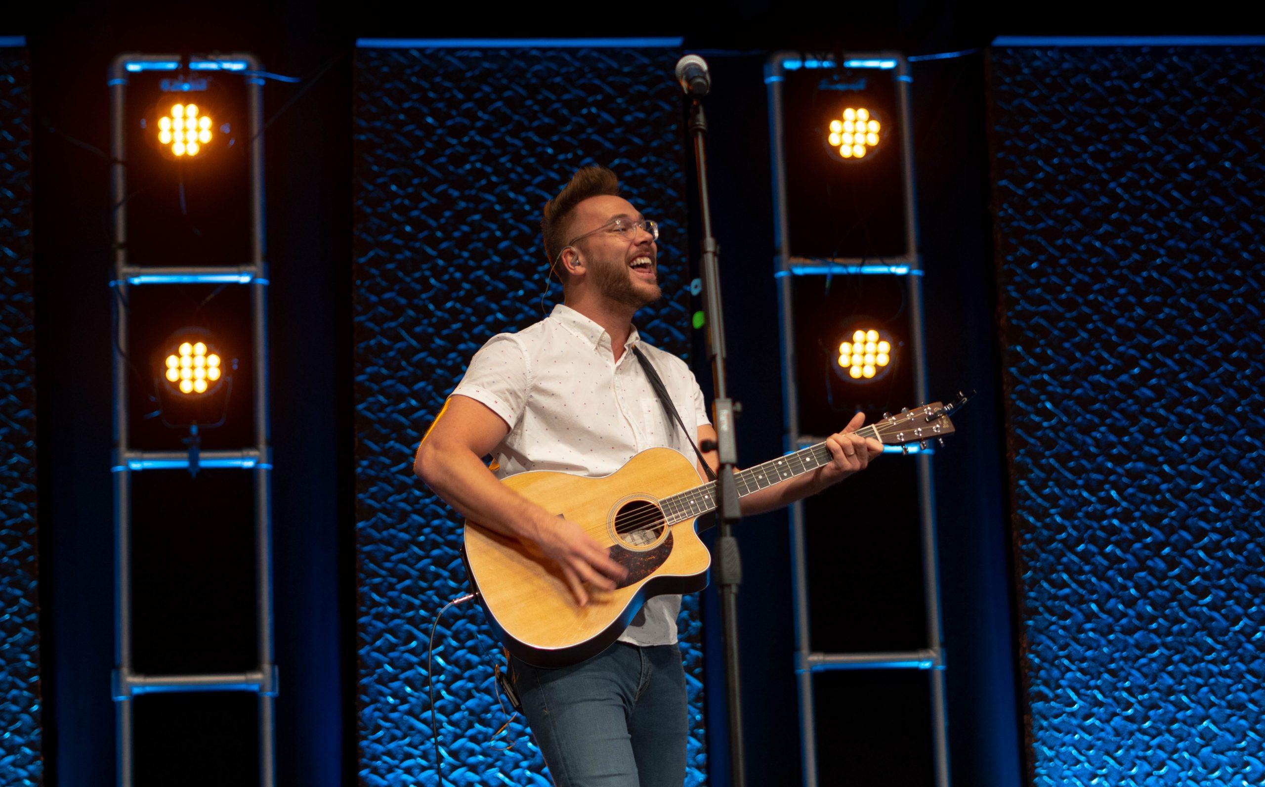 Sam Overla leading worship
